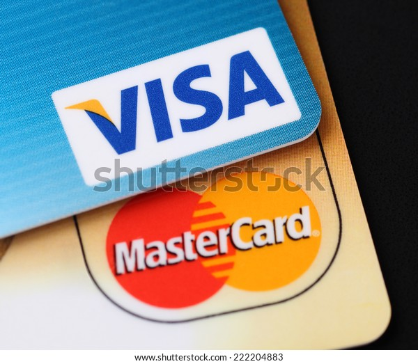 Tambov, Russian Federation - September 11, 2012: Visa and Mastercard logos on credit cards. Black background. Studio shot. Visa and Mastercard are a two biggest credit card companies in the world.