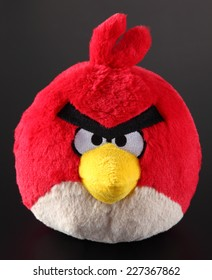 Tambov, Russian Federation - September 22, 2013: Red Angry Birds soft toy on black background. Angry Birds is popular computer games, developed by Rovio Mobile.
