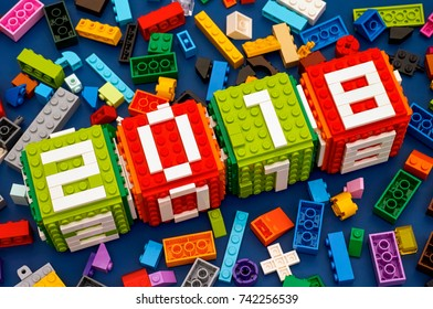 Tambov, Russian Federation - September 28, 2017 Lego New year 2018 concept. Lego cubes  with numbers 2 0 1 8 on blue background with some Lego bricks. Studio shot.