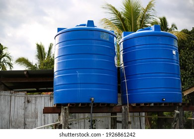 Tambunan, Sabah, Malaysia, February 28, 2021: Blue plastic water tank storage system at rural area