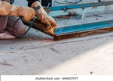 tame welder. the welder welds iron. the welder welds metal. the welder on metal.