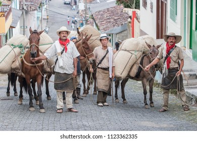 "TAMESIS, ANTIOQUIA, COLOMBIA. June 12 2006. A group of ""Arrieros"" arrives at the municipality of Támesis south west of Antioquia Colombia. ""arrieros are the cowboys of the Andean region of Colombia,"""