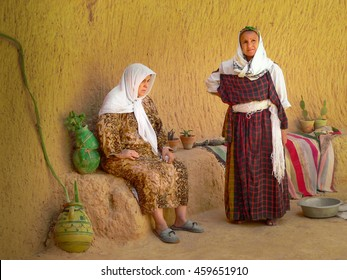 TAMEZRET, TUNISIA - CIRCA SEPTEMBER 2005:two Tunisian women dressed in traditional clothing