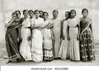 TAMIL NADU, INDIA - May 16, 1992: Indian women wearing saris at a village orphanage for the poor laugh and smile for a group portrait on May 16, 1992 in Nagercoil, Tamil Nadu, South India.