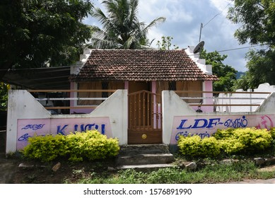 TAMIL NADU, INDIA - SEPTEMBER 20, 2017 : Election campaign advertisements on the compound walls of old house or vintage house made with clay tiles and bricks in rural village in Pollachi .