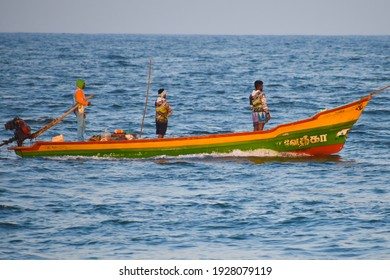 TAMILNADU , INDIA - FEBRUARY 2021 group of Fishermen Sailing on Fishing boat travelling at bay of bengal sea near harbour port