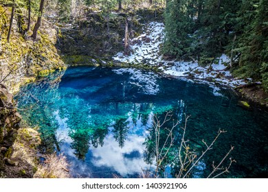 """Tamolitch Falls or Blue Pool is stunning blue water on the McKenzie River in the Willamette National Forest in Oregon. Northwest Indians named this cliff-rimmed basin """"Tamolitch"""" meaning bucket."""