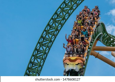 Tampa Bay, Florida. August 08, 2019. People amazing terrific Cheetah Hunt rollercoaster on lightblue cloudy sky background 72