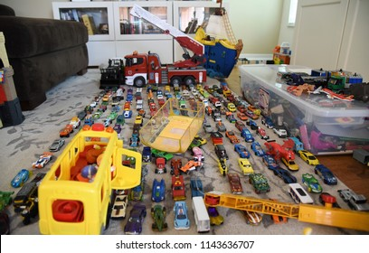 Tampa, FL, July 2018 - hundreds of toy cars are lined up on the living room carpet depicting the abundance of toys, traffic jams and congestion.
