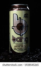 Tampa, FL USA - March 3, 2021: Cookies and Cream Craze high protein ketogenic Bang energy drink with cold condensation in black background