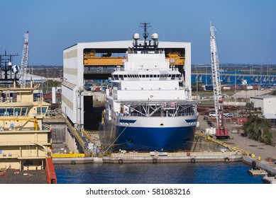 Tampa Florida - February 11th 2016:  Ocean going vessel in dry dock for repairs, February 11th, Tampa Florida
