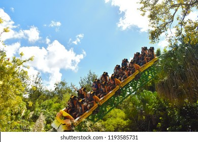 Tampa, Florida; September 29,2018.Amusement Cheetah Hunt rollercoaster at Bush Gardens. Riders proceed over a directional changing airtime hill crossing over the Skyride.