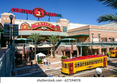 TAMPA, FLORIDA, US - November 29, 2003: Centro Ybor entrance with yellow trams and visiting tourists, Tampa, FL