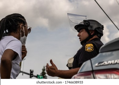 Tampa, Florida / USA - 5/31/20: the only police officer getting along with protesters in full riot gear