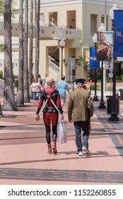 Tampa, Florida / USA - August 4, 2018: Woman in Deadpool Costume and a Young man walking outside the Tampa Convention Center