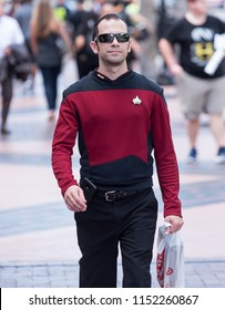 Tampa, Florida / USA - August 4, 2018: Adult man dressed as a Star Trek character walking outside the Tampa Convention Center during Comic Con