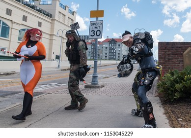 Tampa, Florida / USA - August 4, 2018: Three friends in video game and cosplay costumes outside the Tampa Convention Center during Comic Con