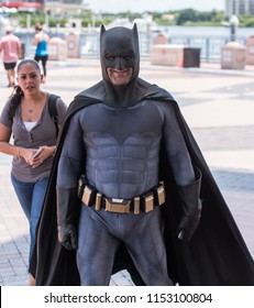Tampa, Florida / USA - August 4, 2018: Adult man dressed as Batman outside the Tampa Convention Center during Comic Con