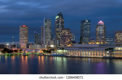 TAMPA, FLORIDA, USA - DECEMBER 10, 2018: Downtown Tampa skyline at night with reflections on river