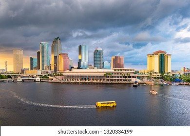 Tampa, Florida, USA downtown skyline on the bay at dusk with water traffic.