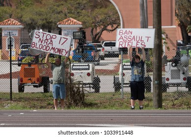 Tampa, Florida / USA - February 25, 2018: Father and Son Protesting the NRA and Assault Rifles at the Florida Gun Show in Tampa, FL