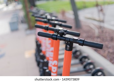 Tampa, Florida / USA - June 29, 2019: Close up of a Row of Spin Shared Electric Scooters in downtown Tampa, FL.