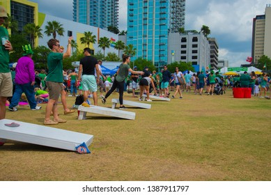 Tampa, Florida USA March 16, 2019 Tampa River Walk During The River O'Green Festival For St. Patrick's Day People Playing Cornhole in the field