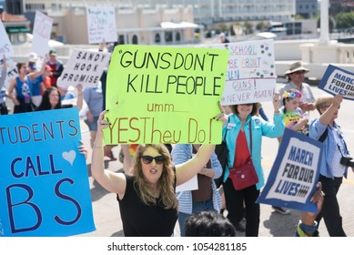 Tampa, Florida / USA - March 24, 2018: Woman with Protesters Marching at the March For Our Lives Rally in Tampa, FL