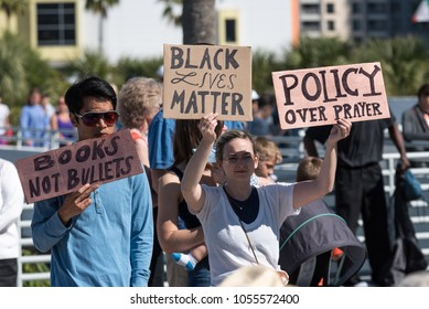 Tampa, Florida / USA - March 24, 2018: Two Protesters Holding Up Signs at the March For Our Lives Rally in Tampa, FL