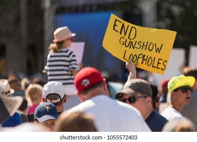 Tampa, Florida / USA - March 24, 2018: Protester Holding a Sign to Close Gun Show Loopholes at the March For Our Lives Rally in Tampa, FL