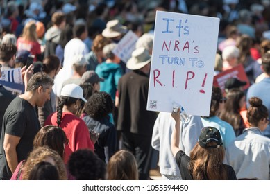 Tampa, Florida / USA - March 24, 2018: Protester Holding Anti NRA Sign at the March For Our Lives Rally in Tampa, FL
