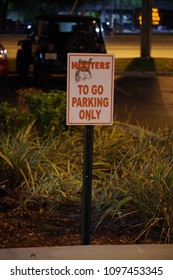 Tampa, Florida / USA - May 5 2018: Hooters TO GO PARKING ONLY Sign