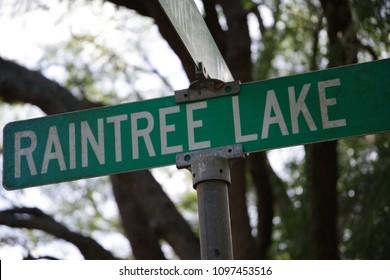 Tampa, Florida / USA - May 5 2018: Raintree Village Blvd and Raintree Lake Lane Street Sign at Intersection