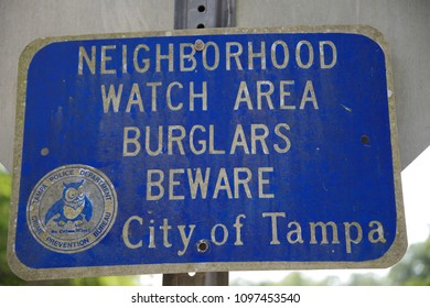Tampa, Florida / USA - May 5 2018: Neighborhood Watch Area Burglars Beware City of tampa Road Sign