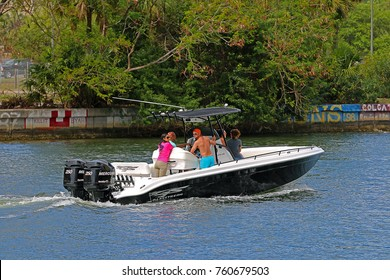 TAMPA, FLORIDA/USA - MARCH 25, 2017: A group of men and women cruising in the Tampa Bay area in their Glasstream Powerboats center console boat with dual Mercury outboard engines.