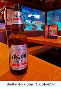 TAMPA, FLORIDA/USA - MARCH 28, 2018: A bottle of Asahi on a table at a local Japanese Restaurant. In 1987 Asahi introduced Asahi Super Dry a product that transformed the modern beer industry in Japan.