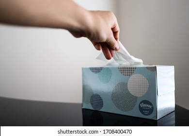 Tampa, FL/USA April 19th, 2020: A box of kleenex tissue next to an alarm clock. In the spring it is allergy season, tree and flower pollen are the problem.