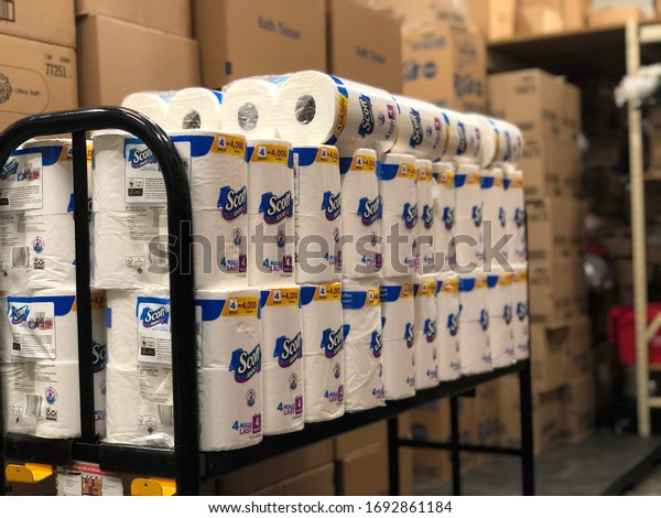 Tampa, FL/USA April 4th, 2020: A bunch of toilet paper in a stock room. Due to the corona virus outbreak toilet paper and paper towel are limited.
