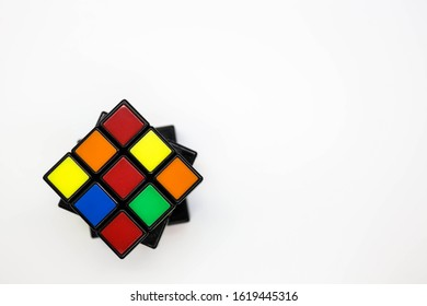 Tampa, FL/USA January 18, 2020: unsolved 3x3 Rubik's cube with a white background top view.