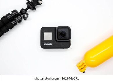 Tampa, FL/USA January 18, 2020: GoPro Hero 8, an action camera that feature fuctions like  hypersmooth, live stream, and timewarp. Flat lay with 2 accessories framing the photo.