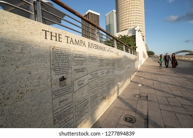 Tampa, FL/USA - May 3, 2017: Tampa's river walk with diverse group of friendly people in background.