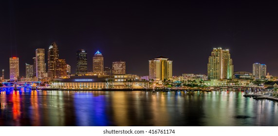 TAMPA, FL/USA - MAY 6, 2016 Panorama of downtown Tampa at night with Hillsborough River and Garrison Channel in the foreground. Photographed from Davis Island.