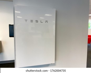 Tampa, FL/USA-5/31/20: A Tesla Battery Powerwall at the Tesla dealership in Tampa, FL.  Tesla, Inc. is an American automotive and energy company that specializes in electric car and solar panels.