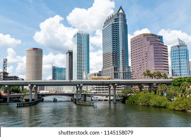 Tampa, USA - April 27, 2018: Downtown city in Florida with bridges, highway, boat yacht, skyscrapers office modern buildings with signs for Wells Fargo, NBC, Sykes, PNC and Bank of America