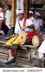 Tampaksiring, Bali / Indonesia - March 17 2017: A Balinese drummer rests at the Pura Tirta Empul (Balinese Temple) before his performance begins in Bali, Indonesia.