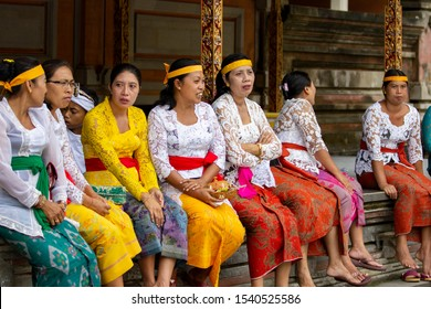 Tampaksiring, Bali / Indonesia - March 17 2017: Balinese women attending a ceremony in the Pura Tirta Empul (Balinese Temple) in traditional dresses in Bali, Indonesia.