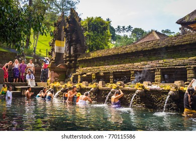 Tampaksiring, BALI, INDONESIA - MARCH 26 : Pura Tirta Empul is a Hindu Balinese water temple popular tourist attraction located near the town of Tampaksiring, Bali, Indonesia on March 26, 2014.