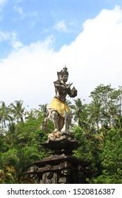 Tampaksiring, Bali/Indonesia - May 24th, 2014: The Hindu statue of God Indra bringing holy water at Tirta Empul Temple, Bali