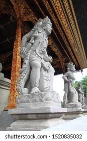 Tampaksiring, Bali/Indonesia - May 24th, 2014: Two statues of Balinese Hindu Gods at Tirta Empul Temple, Bali, Indonesia