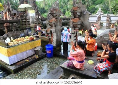 Tampaksiring, Bali/Indonesia - May 24th, 2014: Some Balinese pilgrims are praying at Tirta Empul Temple, Bali